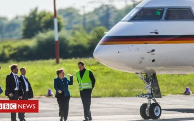 Merkel's plane dented by fan in van
