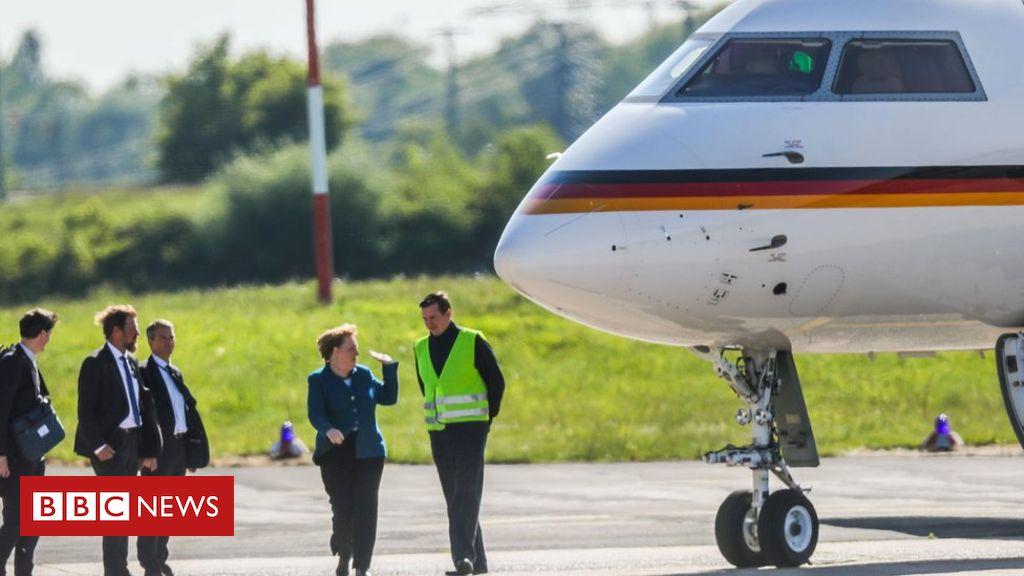 Merkel's plane dented by fan in van