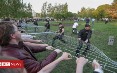Russian activists storm site of new church