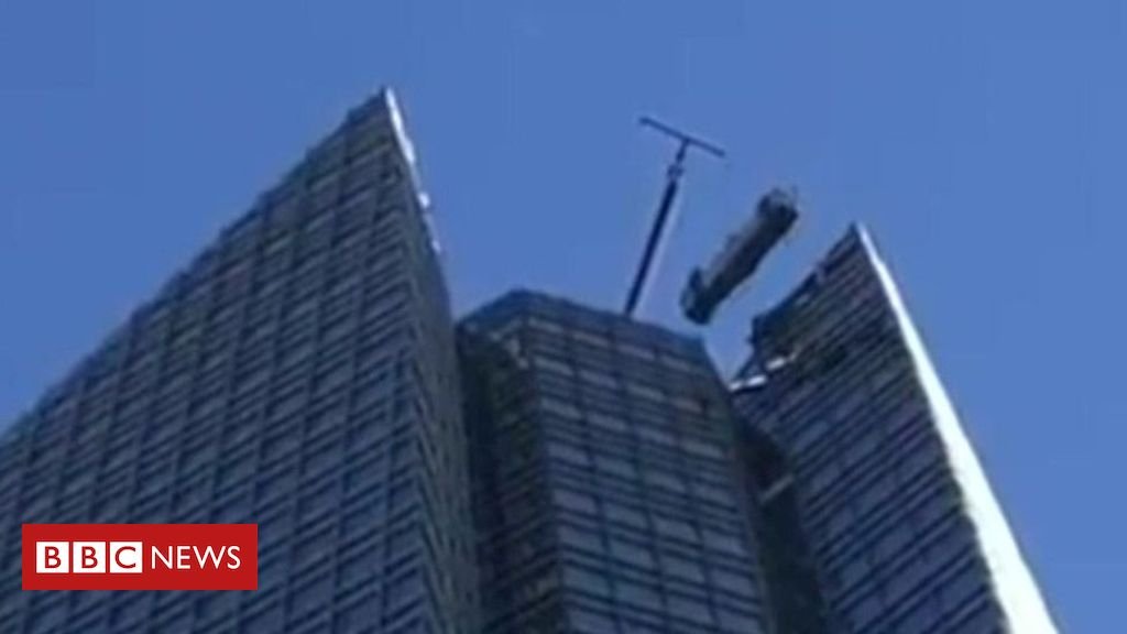 Window cleaners rescued from swinging lift