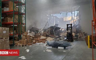 US fighter jet crashes into warehouse