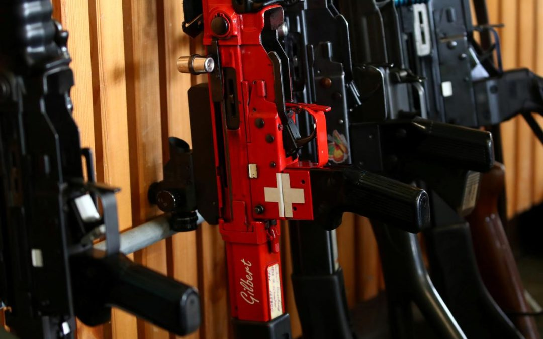 Swiss voters approve tighter gun control: TV – Reuters