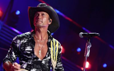 Tim McGraw shows off prized fish in shirtless pic and fans can't help but notice his abs: 'What fish?'