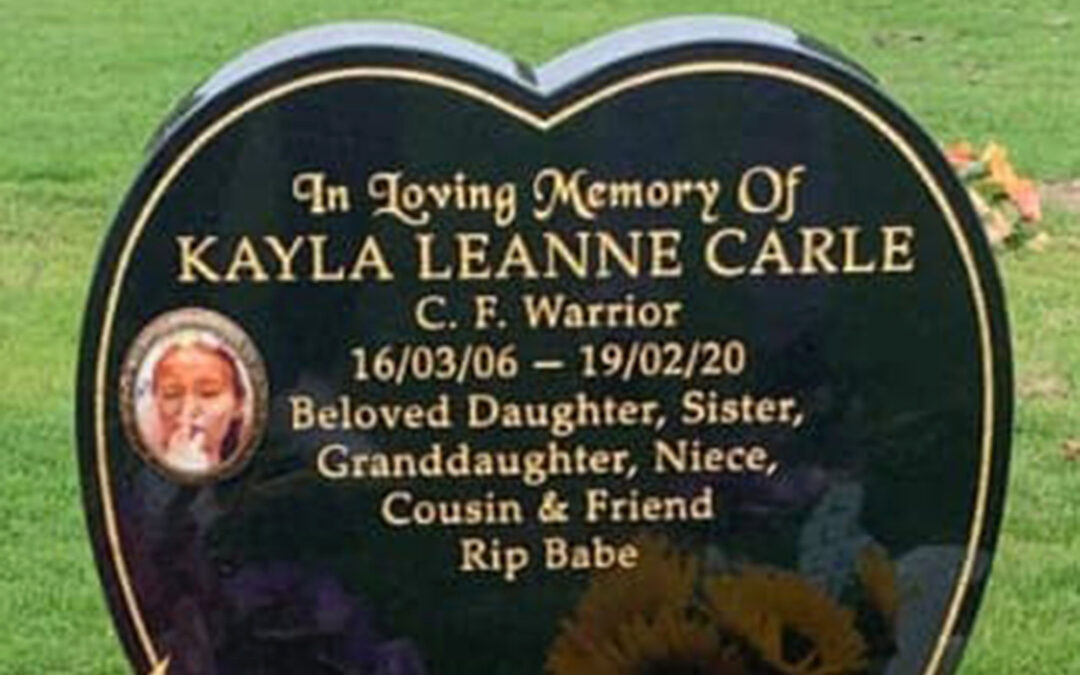 Family fights to keep photo of daughter giving the finger on her gravestone