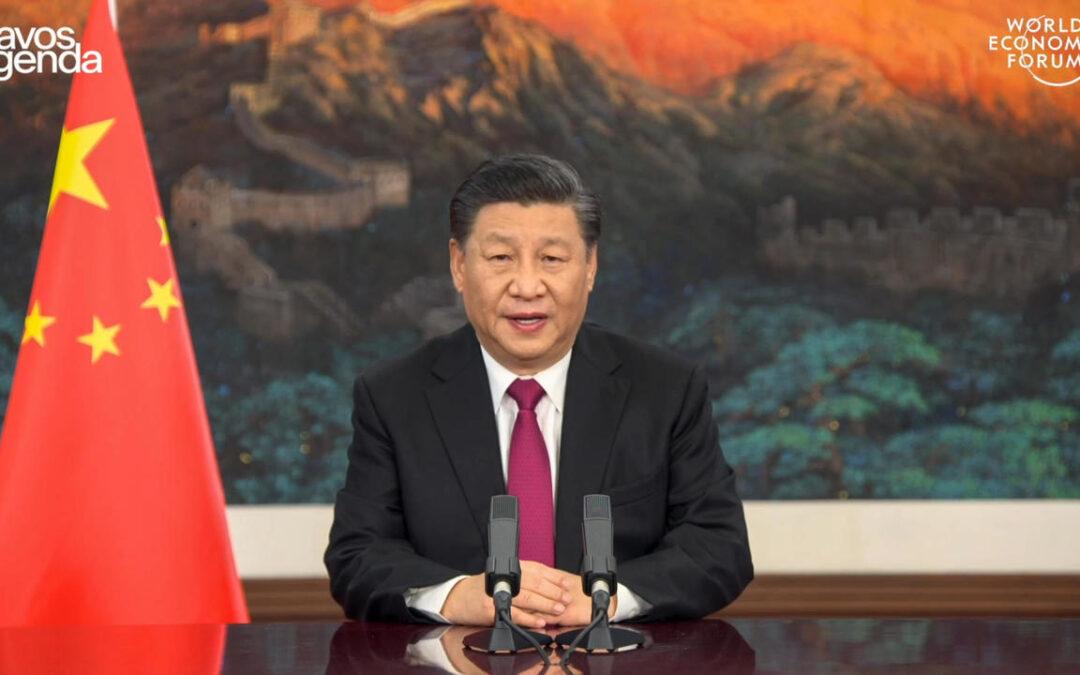 Xi Warns Davos Against 'New Cold War'...