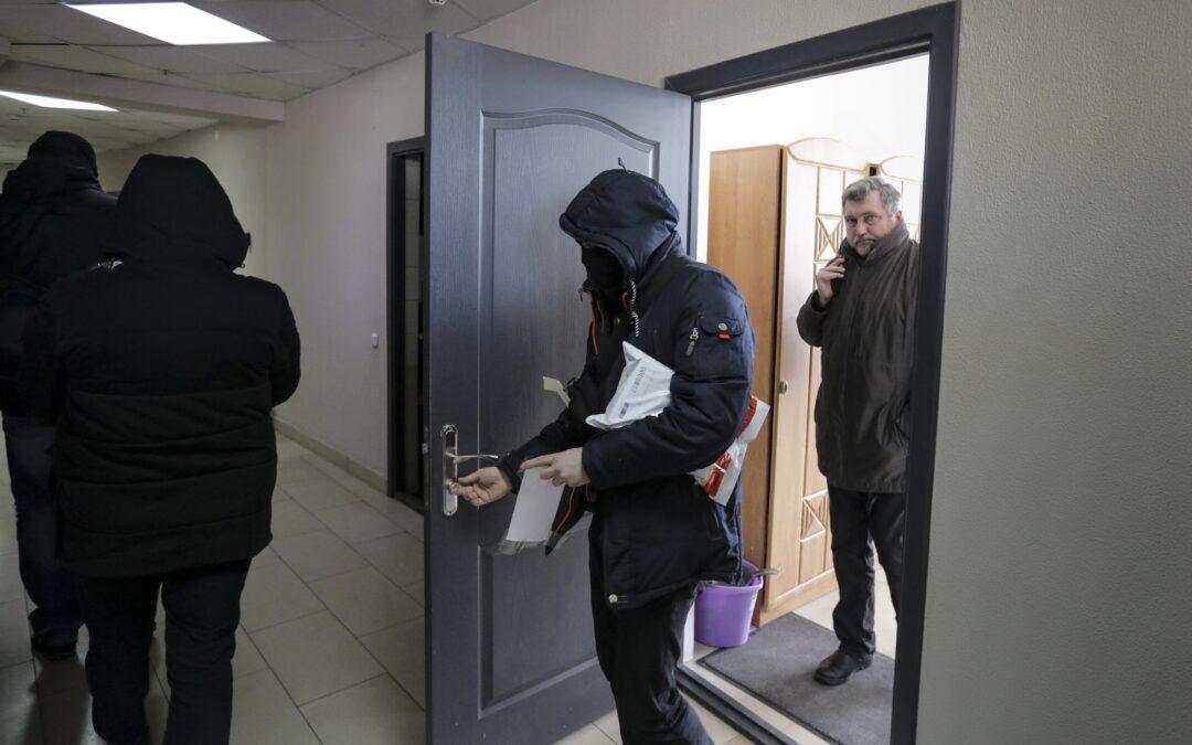 Belarus targets journalists, activists in new raids...
