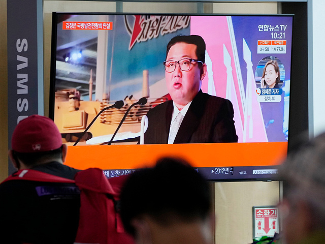 Kim Jong-un, Flanked by Missiles, Claims North Korea's Enemy Is 'War Itself'